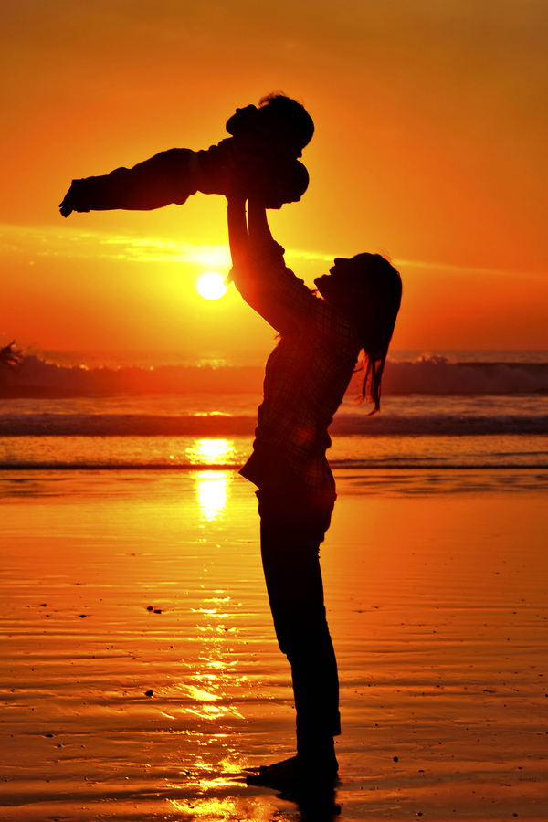 Mother and child at sunset in Oceanside