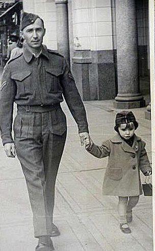 My grandfather walking with my mom, circa WWII
